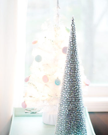 This rhinestone mini Christmas tree craft is a fun and easy holiday DIY idea that would make a great centerpiece or mantle decor.